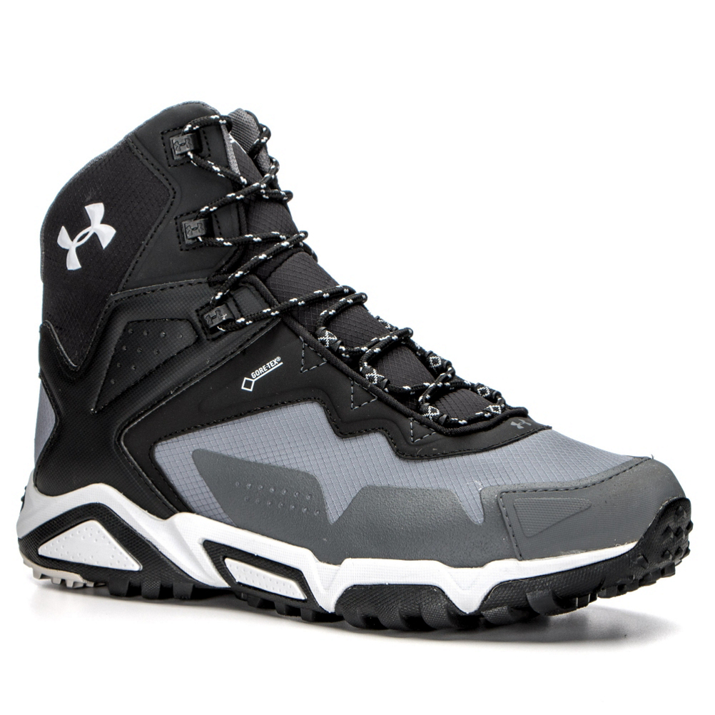 under armour tabor ridge mid hiking boots- Save 40% Off - Never fear the terrain again when you slip on the Under Armour Tabor Ridge Mid Hiking Boots.  The Tabor Ridge has a waterproof upper with GORE-TEX lining so that when you trek through the water you will not get uncomfortable and soggy feet.  With all this durability in the construction you would think it would be a heavy boot, but that is not the case, the Tabor Ridge is lightweight and durable.  There is a rubber toe cap and a high traction rubber sole that will allow it to withstand trail hazards.  There is an anti-microbial Orthlite sockliner with an integrated TPU arch support that will give you the desired support and stability and the internal midsole gives you stability and torsion steadiness when traversing rocky trails.  GORE-TEX Lining,  Ultra-Light, Molded EVA Midsole,  Internal Midsole Plate for Stability,  TPU Toe Cap,  Warranty: Lifetime, Waterproof: Yes, Material: Lightweight, Durable Ripstop Upper with Synthetic Overlays for Support, Type: Boot, Insulated: No, Sole Material: Rugged, High Traction Rubber Outsole, Model Year: 2017, Product ID: 446293, Model Number: 1254918-040 9.0, GTIN: 0888376117047