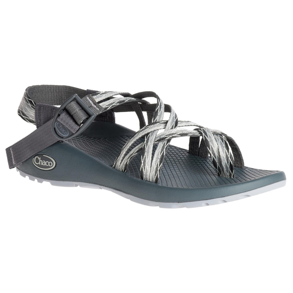 chaco zx2 classic womens sandals- Save 28% Off - Since 1989 Chaco has been making sandals for the everyday adventurer. From hiking to paddling, Chaco sandals can take you anywhere you want to go. The ZX2 Classic is a new twist on the classic Z1, with double thin straps and a toe-loop for additional forefoot control. The adjustable straps custom-fit to your foot while the podiatrist-certified women's specific LUVSEAT PU footbed provides all day comfort and support. The non-marking ChacoGrip rubber outsole ensures traction on slippery, wet surfaces and features 3mm lugs for hiking on variable terrain.  Double-Strapped Adjustable Webbing,  Adjustable Toe Loop,  Durable, High-Tensile Webbing Heel Risers,  Injection-Molded Ladder Lock Buckle,  Women's Specific LUVSEAT PU Midsole,  Antimicrobial Application for Odor Control,  Non-Marking ChacoGrip Rubber Outsole - Optimized for Wet Traction,  3mm Lug Depth,  Weight: 10.5oz,  Warranty: Lifetime, Waterproof: Yes, Material: Double-Strapped Polyester Jacquard Webbing - LUVSEAT PU Midsole, Type: Sandals, Sole Material: Non-Marking ChacoGrip Rubber - 3mm Lug Depth, Model Year: 2017, Product ID: 465268, Model Number: J106102 6.0, GTIN: 0677338985752